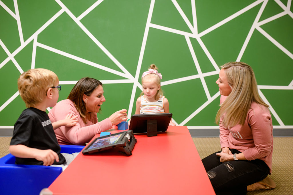 Basal therapists working with two children
